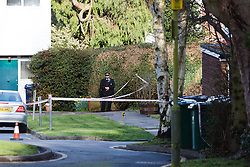 © Licensed to London News Pictures. 30/03/2016. London, UK. A police officer stands at the rear of the police cordon in Green Bank, behind the junction of Woodside Grange Road and Grange Way in North Finchley, Barnet, north London this morning. A young man died after being stabbed at the scene and collapsing yesterday afternoon.  Photo credit : Vickie Flores/LNP