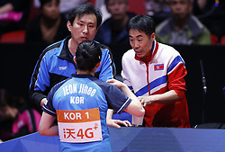 HALMSTAD, May 4, 2018  Jeon Jihee (F) of the combined team of the Democratic People's Republic of Korea (DPRK) and South Korea gets instructions from coaches during the women's semifinal match against Japan at 2018 World Team Table Tennis Championships in Halmstad, Sweden, May 4, 2018. Jeon Jihee lost with 0-3 and the combined team of the Democratic People's Republic of Korea (DPRK) and South Korea lost the match 0-3. (Credit Image: © Ye Pingfan/Xinhua via ZUMA Wire)
