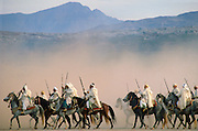 Moroccan horsemen riding in an equestrian Fantasia in Morocco.