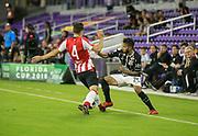 01/10/2018. Orlando, USA.  <br /> <br /> CORINTHIANS SP V PSV EINDHOVEN 2018 Florida Cup.<br /> <br /> CORINTHIANS SP, CLAYSON No 25  TAKES ON PSV'S No 4 SANTIAGO DURING THE FIRST MATCH OF THE 2018 FLORIDA CUP BETWEEN CORINTHIANS AND PSV EINDHOVEN. <br /> <br /> At  ORLANDO CITY STADIUM, Orlando.<br /> Pic: Mark Davison /PLPA
