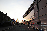 the Sun sets on the South Stand outside White Hart Lane Stadium before k/o. UEFA Europa League round of 16, 2nd leg match, Tottenham Hotspur v Borussia Dortmund at White Hart Lane in London on Thursday 17th March 2016<br /> pic by John Patrick Fletcher, Andrew Orchard sports photography.