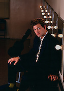 Singer and songwriter Chris Isaak photographed in a green room.
