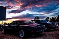 BOLO Photo<br /> Wild West Automotive Photography<br /> Tabula Rasa Twilight<br /> 21 Jul 18<br /> Holiday Twin Drive-In<br /> Fort Collins, Colorado<br /> (1979 Pontiac Trans Am: Heather Wendelboe) <br /> (1987 Buick Turbo T: Wayne Emmons)
