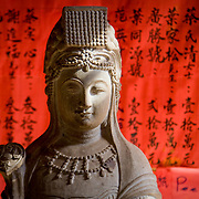 Sculpture on red background with chinese lettering (Hoi An, Vietnam - Nov. 2008) (Image ID: 081107-1354511a)