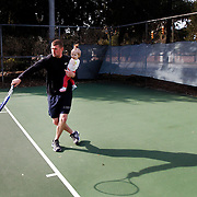 Shane Bishop, of Beaufort, holds his eleven month old daughter Emory Bishop while playing around in the tennis court with his wife Crissy Bishop while at the Beaufort County Tennis Park on February 17, 2014.