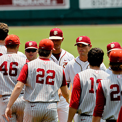 June 06, 2011; Tallahassee, FL, USA; Florida State Seminoles and Alabama Crimson Tide meet following the the Tallahassee regional of the 2011 NCAA baseball tournament as play resumed following the suspension of play due to severe weather last night at Dick Howser Stadium. Florida State defeated Alabama 11-1 to advance to a super regional.  Mandatory Credit: Derick E. Hingle