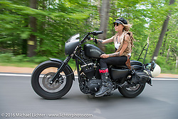 Leticia Cline of the Iron Lilies out riding during Laconia Motorcycle Week 2016. NH, USA. Sunday, June 19, 2016.  Photography ©2016 Michael Lichter.