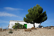Small farm house on an olive grove near to Alhama de Granada, Andalucia, Spain. This is a totally agricultural area, covered mainly with olives. It is a distinctly Mediterranean landscape where blue skies and green life prevails.