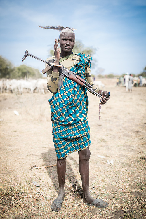 Cattle are often at the centre of violent clashes between communities. With South Sudan's economy in tatters, cows are the most valuable and stable asset families can own. As guns became easier to acquire in the war, competition over resources lead to violent cattle raids, which then ricochet between communities, as people carry out revenge killings. South Sudan, 2020.