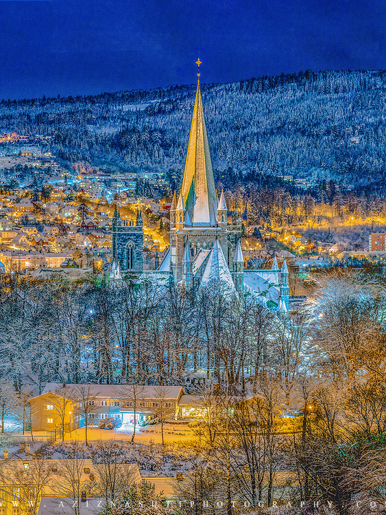 In this picture you can see part of Bakklandet, Nidaros Cathedra, Elgeseter Bru, By[sen, Nidelva River and,...