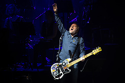 © Licensed to London News Pictures . 01/07/2017 . Manchester , UK . Peter Hook . Hacienda Classical play at the Castlefield Bowl as part of Sounds of the City , during the Manchester International Festival . A collaboration between DJs Mike Pickering and Graeme Park and the Manchester Camerata orchestra , Hacienda Classical reworks music by bands including the Happy Mondays and New Order and features Manchester musicians including Rowetta and Peter Hook . Photo credit : Joel Goodman/LNP