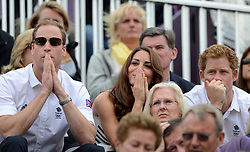 File photo dated 31-07-2012 of The Duke and Duchess of Cambridge wait Prince Harry as Great Britain's Tina Cook performs during the Team Eventing Jumping Final.
