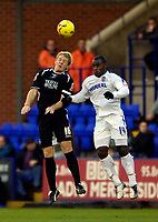 Photo: Jed Wee.<br />Tranmere Rovers v Swansea City. Coca Cola League 1.<br />26/11/2005.<br />Swansea's Garry Monk (L) jumps with Tranmere's Delroy Facey.