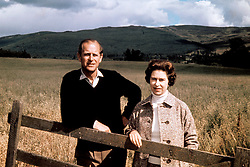 File photo dated 01/09/1972 of Queen Elizabeth II and The Duke of Edinburgh at Balmoral on their Silver Wedding anniversary, as they are celebrating their 69th wedding anniversary today.