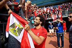 ANN ARBOR, USA - Friday, July 27, 2018: Liverpool's Mohamed Salah signs an autograph on an Egypt flag for a supporter after a training session ahead of the preseason International Champions Cup match between Manchester United FC and Liverpool FC at the Michigan Stadium. (Pic by David Rawcliffe/Propaganda)