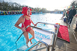 ©  London News Pictures. 26/01/2013. London, UK. A competitor leaving the water following a race at the Cold Water Swimming Championships at Tooting Bec Lido in South London on January 26, 2013. The biannual event sees some competitors dress in costume. Photo credit: Ben Cawthra/LNP