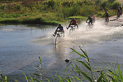 ROBERTSON, SOUTH AFRICA - MARCH 20: Riders cross the Breede river during stage two's 110km from Robertson on March 20, 2018 in Cape Town, South Africa. Mountain bikers from across South Africa and internationally gather to compete in the 2018 ABSA Cape Epic, racing 8 days and 658km across the Western Cape with an accumulated 13 530m of climbing ascent, often referred to as the 'untamed race' the Cape Epic is said to be the toughest mountain bike event in the world. (Photo by Dino Lloyd)