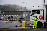 Police manage freight lorry drivers at the French border closures due to a new strain of COVID-19 at the entrance into the port of Dover in the Eastern Dock where the cross channel port is situated with ferries departing to go to Calais in France on the 21st of December 2020, Dover, Kent, United Kingdom. Dover is the nearest port to France with just 34 kilometres (21 miles) between them. It is one of the busiest ports in the world. As well as freight container ships it is also the main port for P&O and DFDS Seaways ferries.  (photo by Andrew Aitchison)