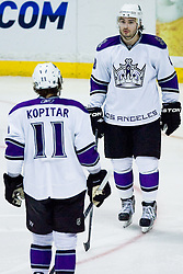 Drew Doughty (Los Angeles Kings, #8) and Anze Kopitar (Los Angeles Kings, #11) during ice-hockey match between Anaheim Ducks and Los Angeles Kings in NHL league, Februar 23, 2011 at Honda Center, Anaheim, USA. (Photo By Matic Klansek Velej / Sportida.com)
