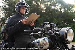 Todd Cameron on his BSA stopped at a roadside checkpoint while filling in the daily pop quiz on the Cross Country Chase motorcycle endurance run from Sault Sainte Marie, MI to Key West, FL. (for vintage bikes from 1930-1948). Stage-7 covered 249 miles from Macon, GA to Tallahassee, FL USA. Thursday, September 12, 2019. Photography ©2019 Michael Lichter.