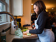 27 NOVEMBER 2019 - DES MOINES, IOWA: US Senator KAMALA HARRIS (D-CA) talks washes and chops leeks and carrots while preparing a Thanksgiving meal for her family in Des Moines Wednesday. Sen. Harris is spending the holiday weekend in Des Moines. Senator Harris is running to be the Democratic nominee for the US Presidency in 2020. Iowa hosts the first selection event of the presidential election season. The Iowa caucuses are February 3, 2020.             PHOTO BY JACK KURTZ