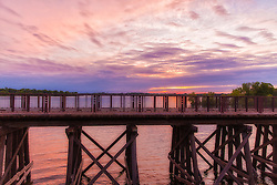 Landscape View Of The Arcola Bridge Over Lake Minnetonka, Minnesota at Sunset Withe pink and purple skies and rolling clouds