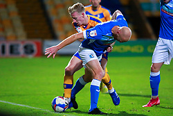 Harry Charsley of Mansfield Town tussles with Jason Taylor of Barrow - Mandatory by-line: Ryan Crockett/JMP - 27/10/2020 - FOOTBALL - One Call Stadium - Mansfield, England - Mansfield Town v Barrow - Sky Bet League Two