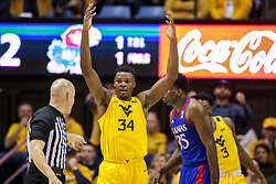 Feb 12, 2020; Morgantown, West Virginia, USA; West Virginia Mountaineers forward Oscar Tshiebwe (34) reacts after being called for a foul during the second half against the Kansas Jayhawks at WVU Coliseum. Mandatory Credit: Ben Queen-USA TODAY Sports