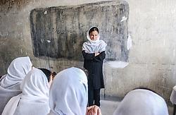 Women study at the Abul Qasim Fierdousi Girls secondary school  in Kabul, Afghanistan  August  08, 2002.    (photo by Ami Vitale)