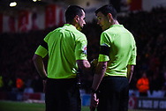 Peter Bankes (Referee) speaks to his assistant before awarding a penalty to Doncaster during the The FA Cup fourth round match between Doncaster Rovers and Oldham Athletic at the Keepmoat Stadium, Doncaster, England on 26 January 2019.
