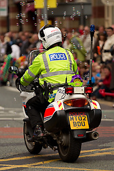 © licensed to London News Pictures. Manchester, UK  19/06/2011. Thousands of Mancunians line the streets of Manchester City Centre to watch the annual Manchester Day Parade, which celebrates Manchester life and culture. Getting in to the spirit of the event, this motorcycle policeman sprayed bubbles from the back of his bike as he cleared the road for the parade. Please see special instructions for usage rates. Photo credit should read Joel Goodman/LNP