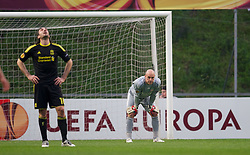 BRAGA, PORTUGAL, Thursday, March 10, 2011: Liverpool's goalkeeper Jose Reina and defender Sotirios Kyrgiakos look dejected after conceding the opening goal from the penalty spot to Sporting Clube de Braga, it was Kyrgiakos who conceded the foul for the penalty, during the UEFA Europa League Round of 16 1st leg match at the Estadio Municipal de Braga. (Photo by David Rawcliffe/Propaganda)