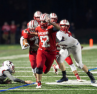 Laconia's Caleb Hounsell and Jake Ellis charge down field during Friday night football against Trinity.  (Karen Bobotas/for the Laconia Daily Sun)