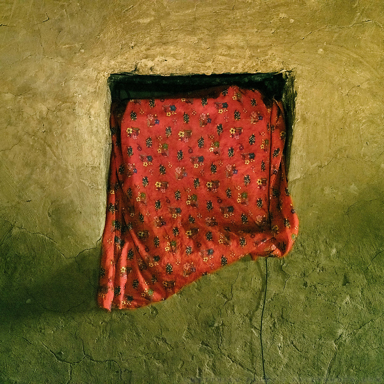 Television covered in cloth, to keep the dust off. TV is a precious thing to them. Everyday, there is usually electricity only between 6pm and 10pm.  The traditional life of the Wakhi people, in the Wakhan corridor, amongst the Pamir mountains.