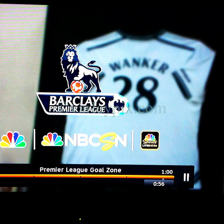 17 August 2014. New Orleans, Louisiana.<br /> 'Wanker' - Someone having fun at NBC Sports Network with the name on the back of a footy shirt during the 'Premier League Goal Zone.' <br /> Photo; Charlie Varley/varleypix.com<br /> NB; Usage Fee $500 applies.