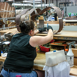 Nazareth, PA, USA - October 27, 2014:  A craftperson building a new guitar at the Martin Guitar Company in Nazareth, Pennsylvania.