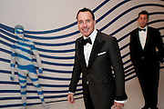 DAVID FURNISH, Grey Goose character and cocktails. The Elton John Aids Foundation Winter Ball. off Nine Elms Lane. London SW8.  chef Marcus Wareing was in charge of dinner.30 October 2010. -DO NOT ARCHIVE-© Copyright Photograph by Dafydd Jones. 248 Clapham Rd. London SW9 0PZ. Tel 0207 820 0771. www.dafjones.com.