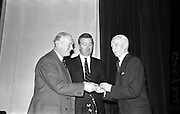 28/03/1963<br /> 03/28/1963<br /> 28 March 1963<br /> Royal Horticultural Society of Ireland Presentation of Gold medals. The Right Honorable Earl of Rosse, President of the Royal Horticultural Society of Ireland(left) presents the Society's special gold medials for Rose growing to Mr. Alex Dixon, Newtownards, (right) and Mr. Sam McGredy at the Royal Horticultural Society 16 St. Stephen's Green, Dublin.