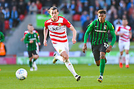John Marquis of Doncaster Rovers (9) and Dujon Sterling of Coventry City (17) in action during the EFL Sky Bet League 1 match between Doncaster Rovers and Coventry City at the Keepmoat Stadium, Doncaster, England on 4 May 2019.