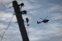 © Licensed to London News Pictures. 19/09/2011. Crays Hill, UK. A police helicopter hovers overhead Dale Farm Essex today (19/09/2011). Activists and residents at the Dale Farm travellers site in Essex prepare for the council to enforce an eviction notice which is due to start today (19/09/2011). Photo credit: Ben Cawthra/LNP