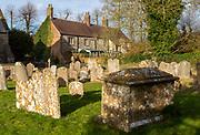 Old weathers stone gravestones in churchyard, Avebury village, Wiltshire, England, UK