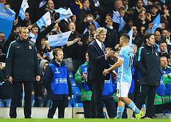 Sergio Aguero of Manchester City shakes hands with Manchester City Manager, Manuel Pellegrini  - Mandatory byline: Matt McNulty/JMP - 07966386802 - 12/04/2016 - FOOTBALL - Etihad Stadium -Manchester,England - Manchester City v Paris Saint-Germain - UEFA Champions League - Quarter Final Second Leg