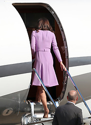 The Duchess of Cambridge boards a plane in Hamburg at the end of the royal visit to Germany.