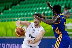 Sam Van Rossom #5 of Belgium pass the ball during basketball match between National teams of Belgium and Ukraine at Day 1 of Eurobasket 2013 on September 4, 2013 in Tivoli Hall, Ljubljana, Slovenia. (Photo By Urban Urbanc / Sportida.com)