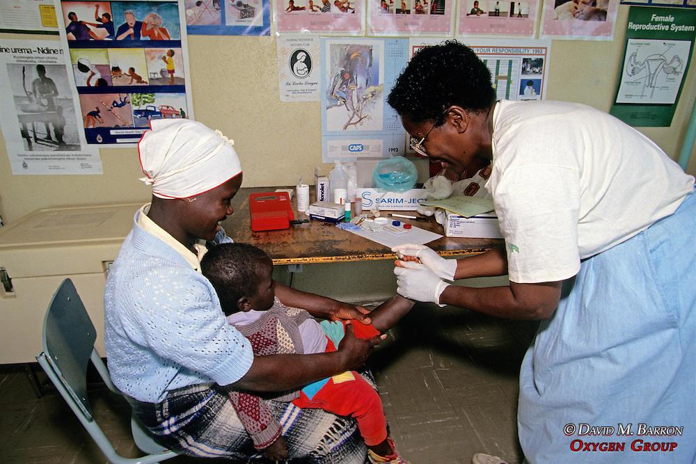 Prisca Nemapare Taking Blood From Child