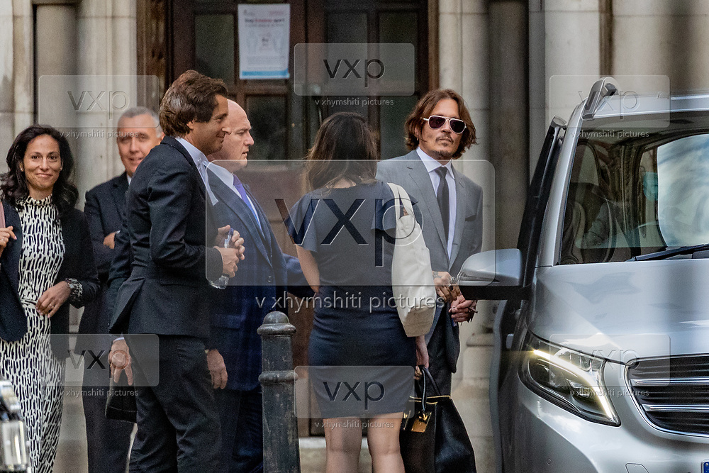"""American actor Johnny Depp leaves the High Court in London, Monday, July 13, 2020. Depp is expected to have wrapped up his evidence at his libel trial against a tabloid newspaper that accused him of abusing ex-wife Amber Heard. The Hollywood star is suing News Group Newspapers, publisher of The Sun, and the paper's executive editor, Dan Wootton, over an April 2018 article that called him a """"wife-beater."""" (VXP Photo/ Vudi Xhymshiti)"""