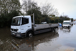 © Licensed to London News Pictures. 22/11/2016. Rotherham, UK. A truck pulls a stranded van from a flooded road in Rotherham, South Yorkshire, after a river broke it's banks last night. Storm Angus has brought heavy wind and rain to much of the UK this week with flooding seen all over. Photo credit : Ian Hinchliffe/LNP