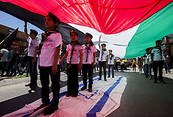 June 23, 2017 - Gaza City, The Gaza Strip - Palestinians stand on Israeli flag as they take part in a protest marking the annual al-Quds Day, or Jerusalem Day, in Gaza City. (Credit Image: © Mahmoud Issa/Quds Net News via ZUMA Wire)