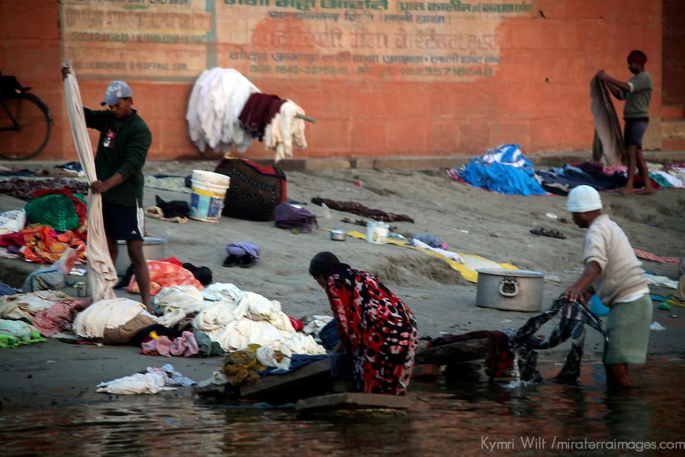 Asia, India, Varanasi. Locals doing laundry in the holy Ganges River in Varanasi.