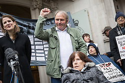 © Licensed to London News Pictures. 09/11/2016. London, UK. Paul Rutherford, Sue Rutherford, Jayson Carmichael and Charlotte Carmichael make a statement outside the Supreme Court, London, after winning an appeal against the bedroom tax. The bedroom tax was unfairly restricting their housing subsidies. Photo credit : Tom Nicholson/LNP
